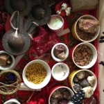 Miriam's trunk contains different stones, grains, jewelry and instruments that she uses to help people.