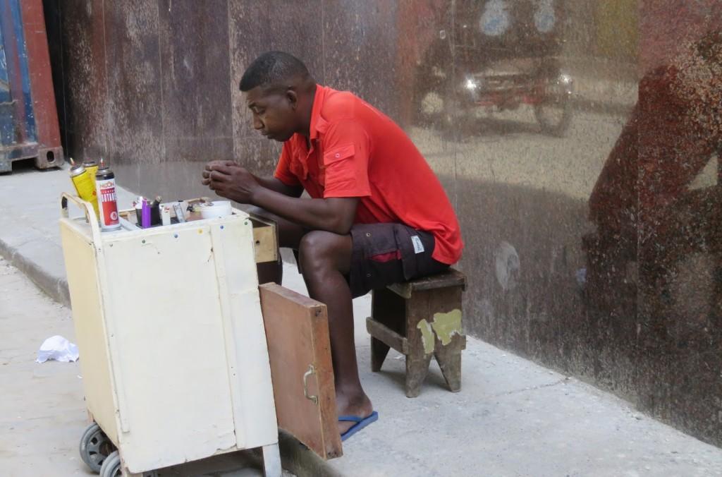 Private enterprise: a vendor refilling disposable lighters.