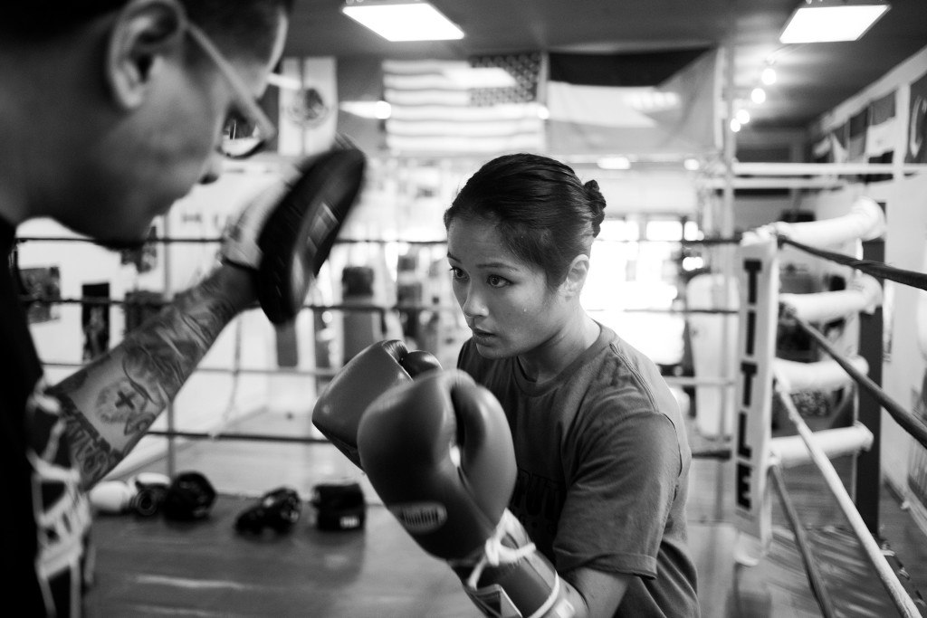 Jairo Escobar, Casey's full-time coach, spars with Casey in the ring to improve her strategy and work on some new boxing techniques at World Class Boxing Gym in San Francisco, CA.