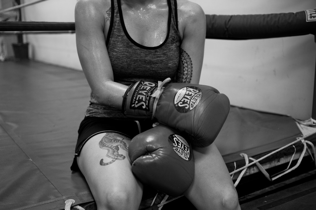 Casey takes a short break on the side of the ring in between a sparring session at World Class Boxing Gym in San Francisco, CA.