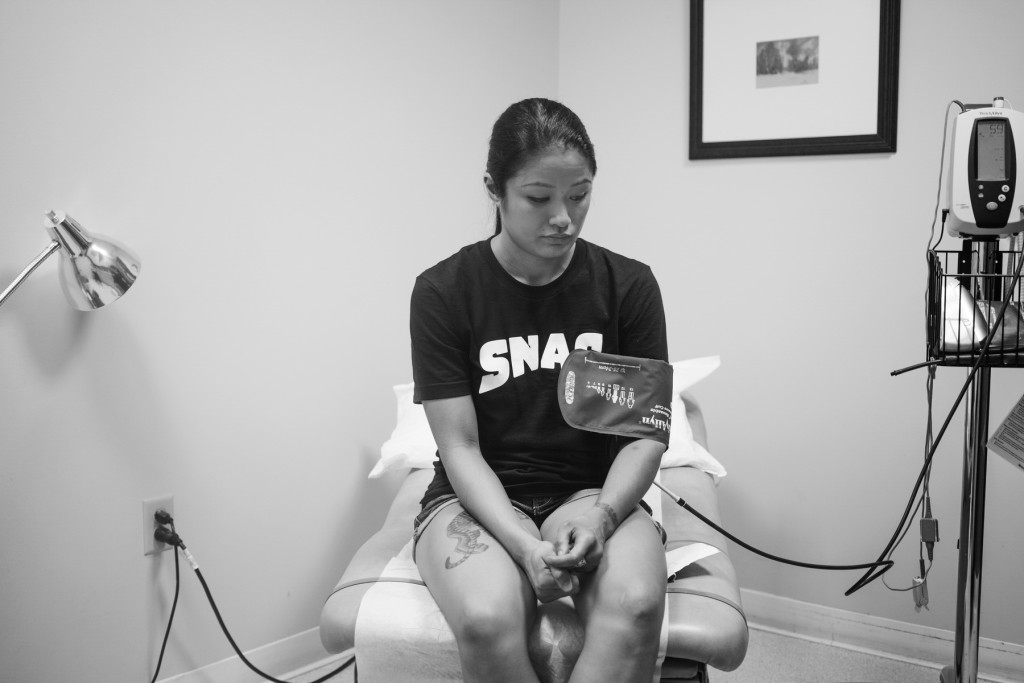 Casey awaits for her doctor to take her blood-pressure reading. This is one of many physical tests Casey must get in order to prove she is healthy for her pro-debut.