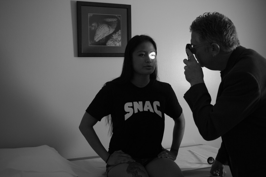 A physician checks Casey's eye-sight during a pre-fight physical exam in San Jose, CA. This exam is one of many appointments Casey must complete in order to qualify for her pro-debut.
