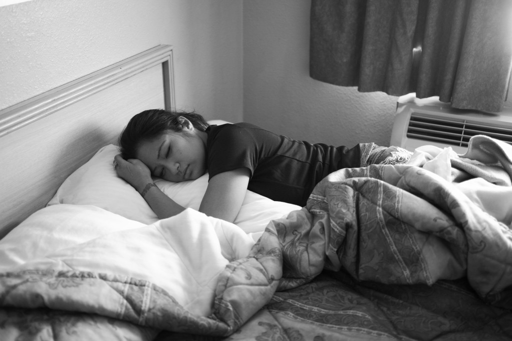 Casey tries to take a quick nap in-between weigh-in sessions before her pro-debut fight.