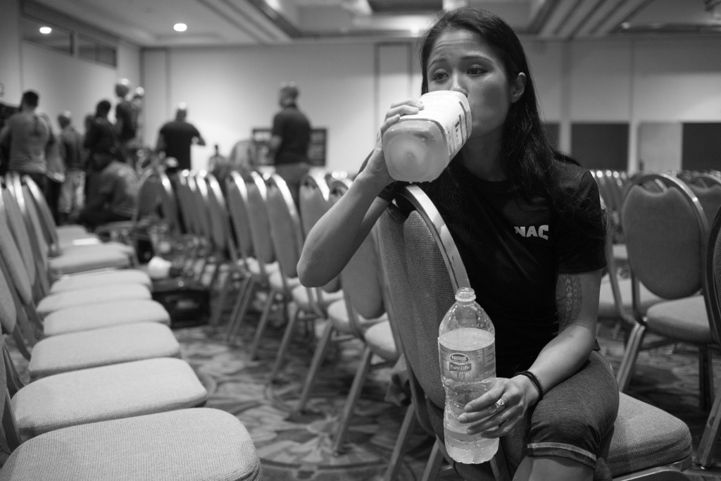 To ward off hunger pains, Casey drinks large amounts of water and meal supplements after her first weigh-in for her pro-debut. Boxers are restricted to very little food and liquid intakes the day before weigh-ins so that they can make their goal weight.