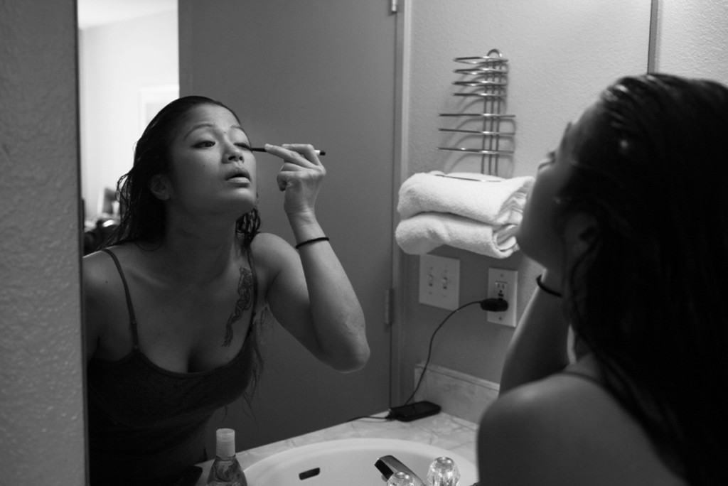 Some last minute eye-liner is applied before Casey leaves her hotel room to prepare for her pro-debut fight.