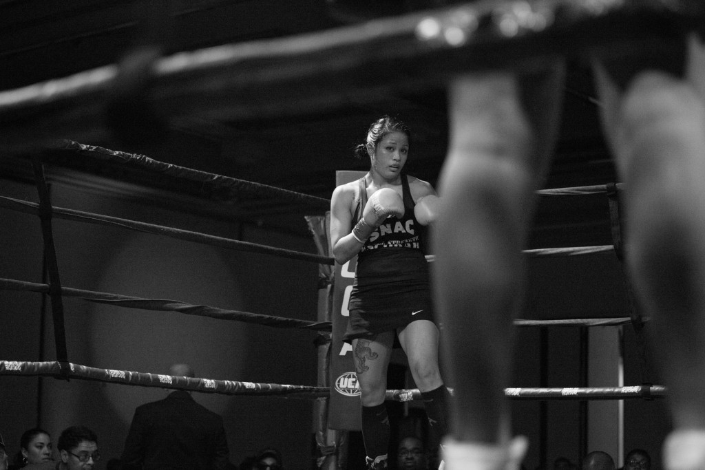 Both Casey and her opponent, Blanca Raymundo, wait in their designated corners and get ready to begin the fight in Sacramento, CA.