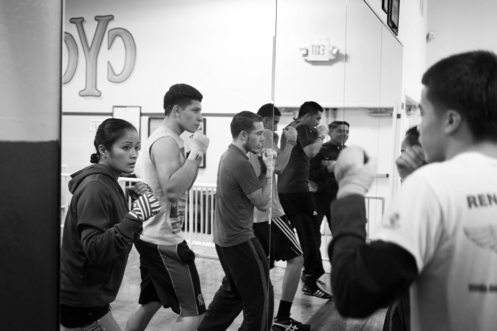 Casey practices warming-up with teenage male fighters she trains once a week at her boxing class at the Community Youth Center in Concord, CA.