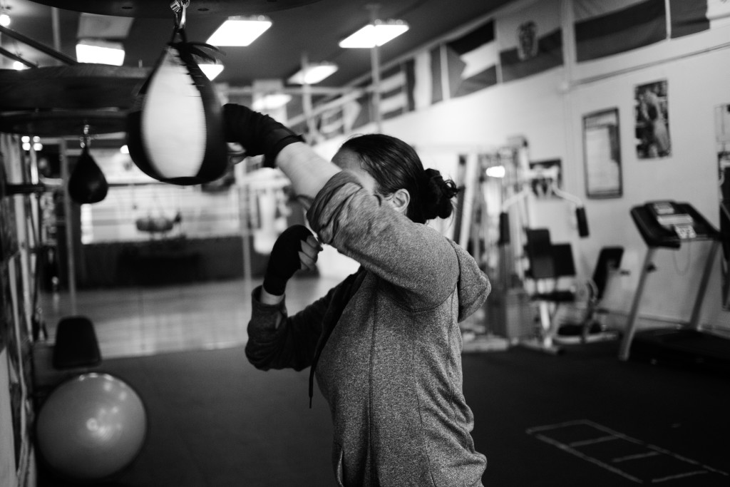 Casey practices her punches on a speed bag at World Class Boxing Gym in San Francisco, CA.