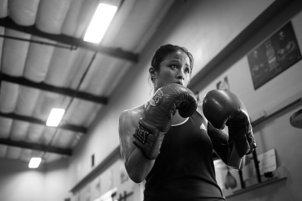 Casey practices training by herself at Undisputed Boxing Gym to improve techniques and practice self-discipline for her upcoming boxing fights.