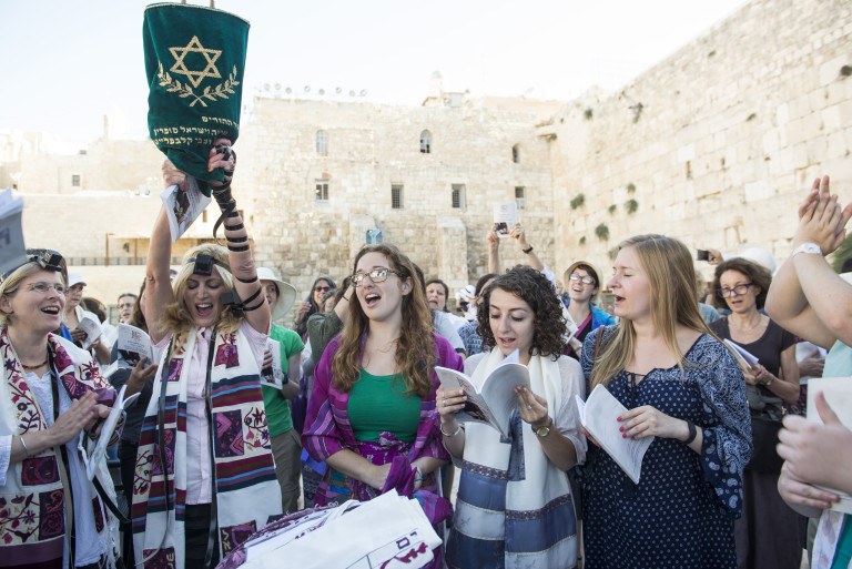 Women of the Wall protesters gather at the Western Wall in Jerusalem on July 7, 2016 to sing and pray in opposition to Orthodox law. While the Reform and Conservative movements of Judaism allow women to wear prayer shawls and read Torah, the Western Wall adheres to the Orthodox agenda and discourages women from doing such. (Photo courtesy of Danielle Shitrit)